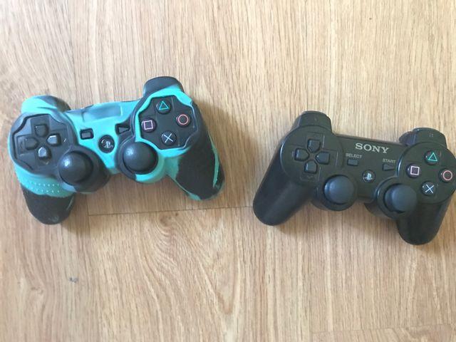 Ps3 casi nueva incluye nueve juegos 500gb 2 mandos