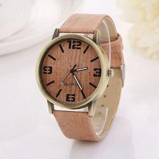 Relojes de cuarzo terminación madera