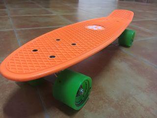 Penny (patinete) naranja nuevo