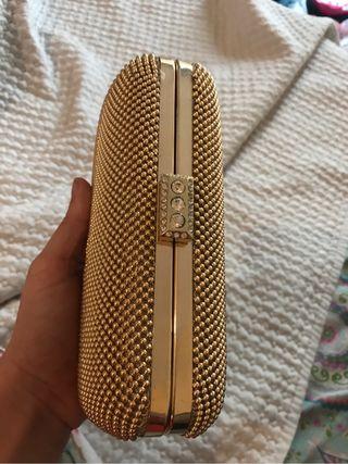 Bolso de mano dorado