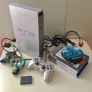 Playstation 2 con 4 juegos 8m