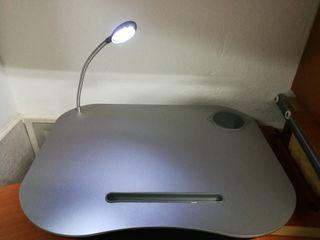 reposa ordenador portátil con luz
