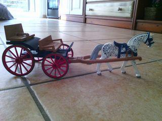 Carro arrastrado por caballo