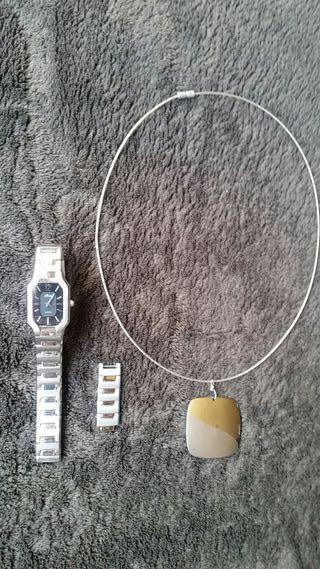 Reloj Lotus con colgante a juego de regalo
