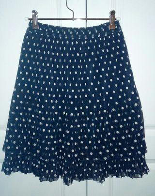 Falda plisada lunares