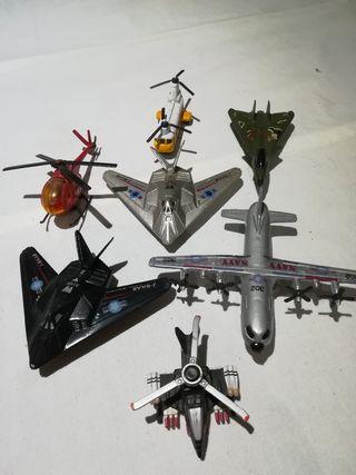 conjunto de aviones y helicopteros