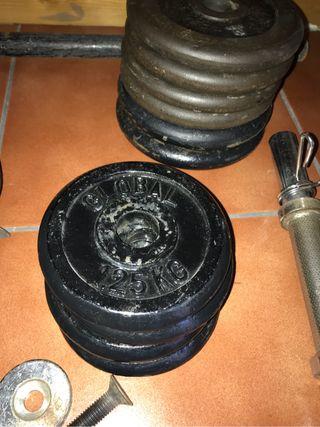 Discos de pesas y mancuerna