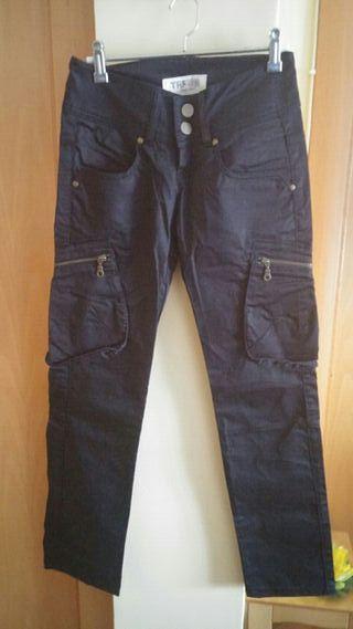 Pantalones Zara negros.