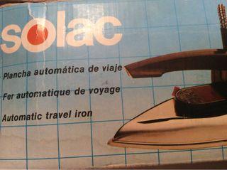 Plancha de viaje para ropa