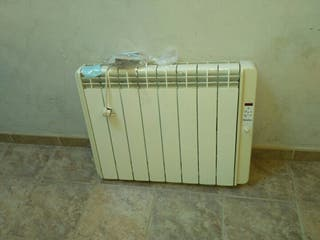 dos radiadores electricos con termostato