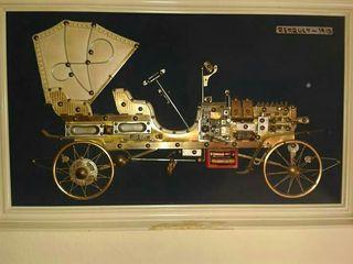 cuadro de coche de epoca hecho con piezas reciclad