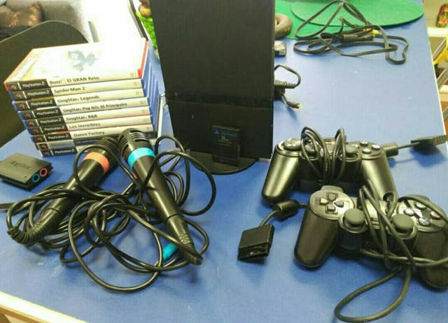 play station 2 + dos complementos