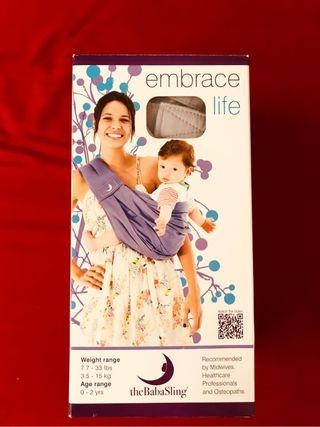 Portabebes The baba sling. Embrace life