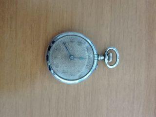Antiguo reloj de bolsillo de plata