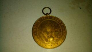 antigua medalla escolar