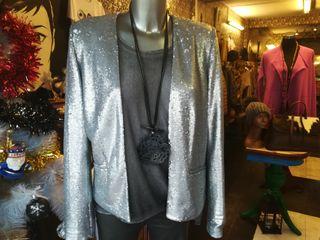 chaqueta plateada de lujo, para una velada especia