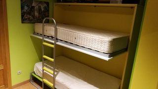 Camas abatibles con colchones y armario