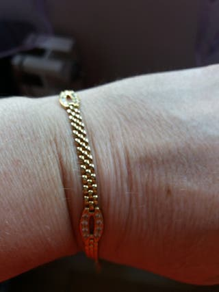 Preciosa pulsera de oro 18kl y circonitas