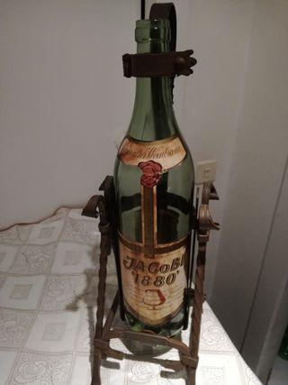 Adorno la botella grande con el soporte de forja