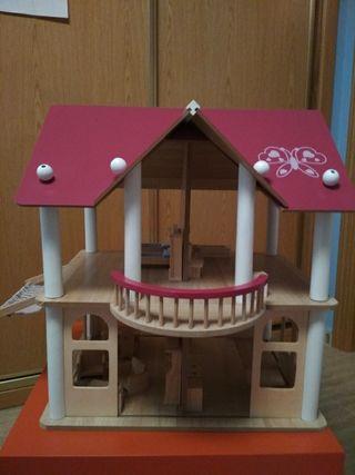 casa de muñecas con muebles a estrenar