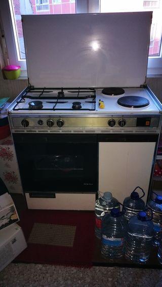 cocina a gas y corriente