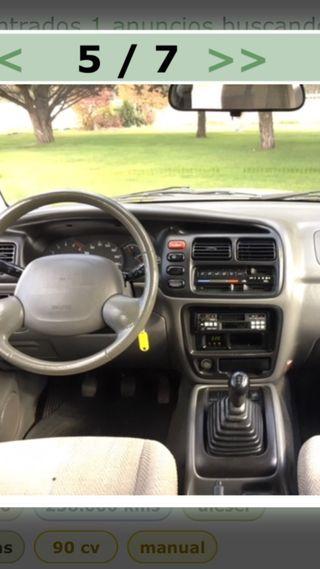 Suzuki Grand vitara 2000 acepto cambio moto coche.