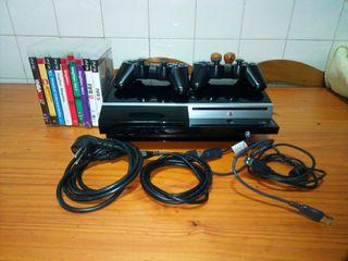 PS3 con dos mandos y nueve juegos