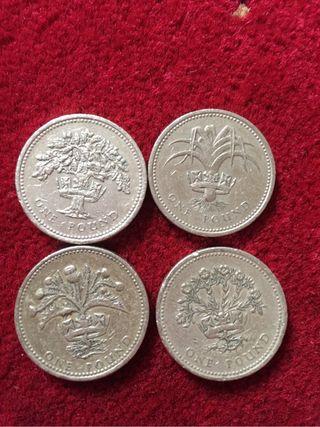 1 pound coin set of 4 coins .