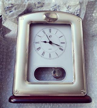 reloj péndulo plata