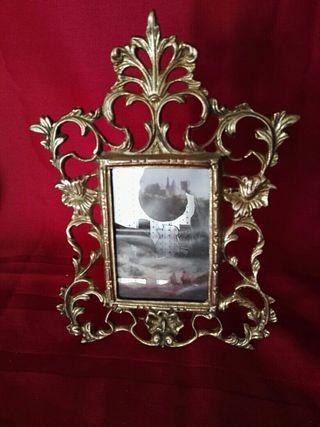 marco de fotos de bronce
