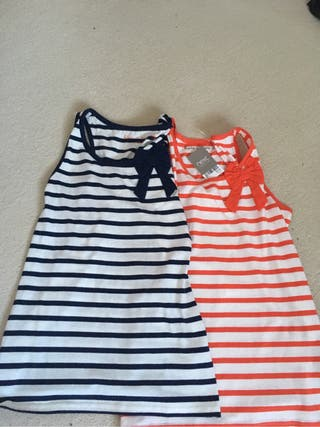 Two 11-12 vest tops