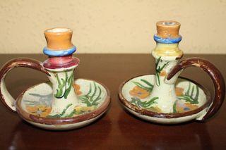 Palmatorias y botijas de cerámica.