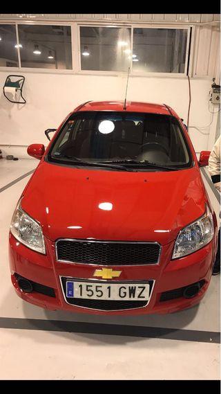 Chevrolet Aveo 2010, rojo gasolina, un solo dueño,