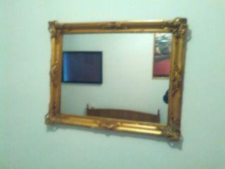Espejo vintage color oro.