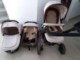 Carro bebé tb contiene Paragua y el plastico