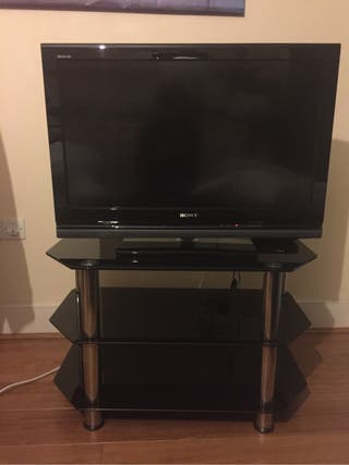 Black glass tv stand + Sony Bravia HD TV