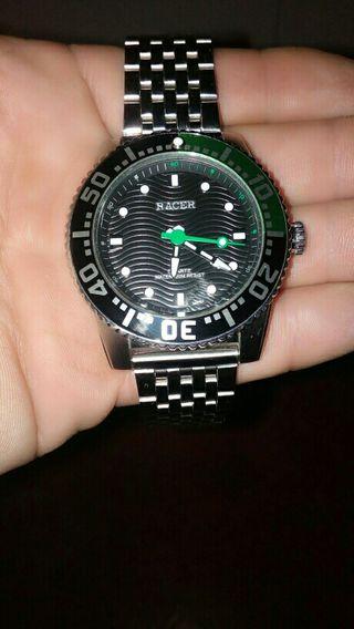vendo reloj marka Racer en perfecto estado poko us