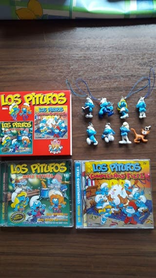 3 Cd los pitufos + muñecos