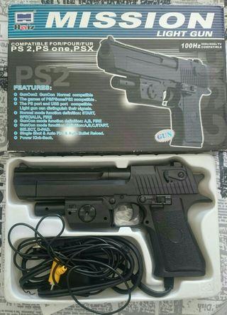 Pistola PS2. Accesorio de videojuegos.