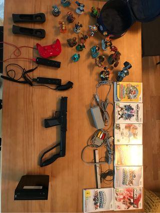 Conjunto Wii + accesorios + juegos