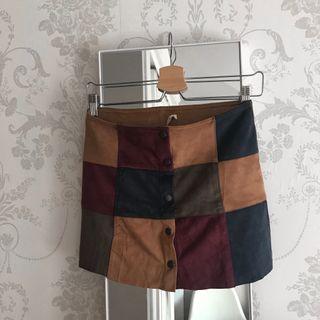 Minifalda cuadros con botones