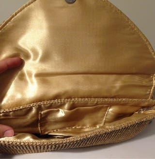 Bolso mano dorado