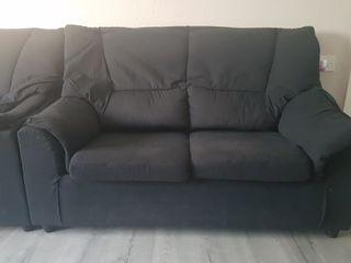 vendo dos sofas de dos y tres plazas color negro