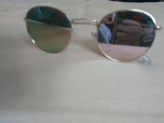 Gafas espejo rosas y doradas