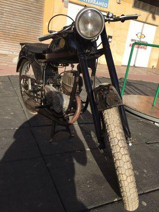 Moto antigua Ossa palillos