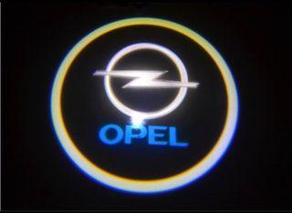 Luz proyector logo OPEL