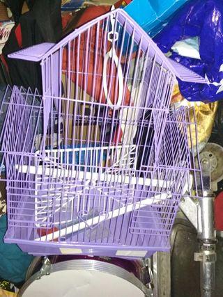 jaula para pajaro con todos los accesorios