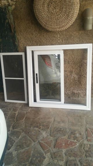 ventana ,de climallit y reja