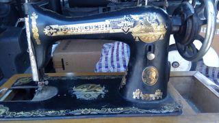 Máquina de coser singer antigua