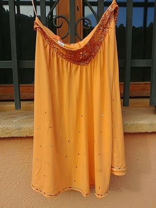 falda naranja co lentejuelas